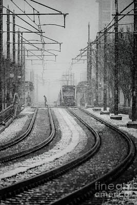 Snowy Tracks To Lightrail Poster by Robert Yaeger