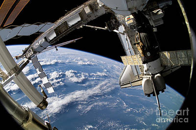 Space Shuttle Atlantis And A Soyuz Poster by Stocktrek Images