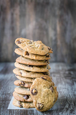 Stack Of Chocolate Chip Cookies With One Leaning Kitchen Art Poster by Carol Mellema