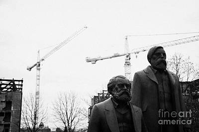 statues of marx and engels with deconstruction of the palast der republik in the background Berlin Germany Poster by Joe Fox