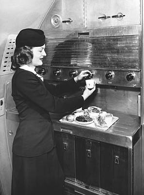 Stewardess Preparing Dinner Poster by Underwood Archives