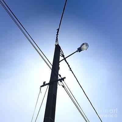 Street Lamp And Power Lines Poster by Bernard Jaubert