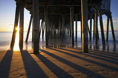 Sunlit Pilings Poster by Eric Gendron