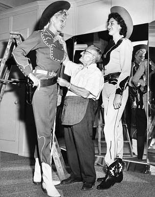 Tall Cowgirls Get Fitted Poster by Underwood Archives