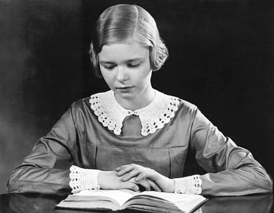 Teenage Girl Reading A Book Poster by Underwood Archives