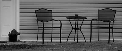 The Patio Chairs In Black And White Poster by Rob Hans
