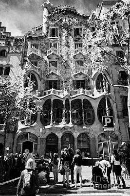 tourists outside casa batllo modernisme style building in Barcelona Catalonia Spain Poster by Joe Fox
