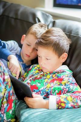 Two Boys Using A Digital Tablet Poster by Samuel Ashfield