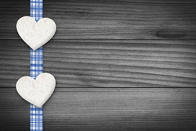Two Hearts Laying On Wood Poster by Aged Pixel