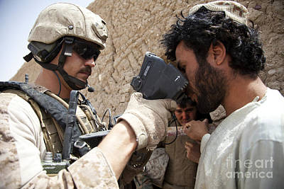 U.s. Marine Scans An Afghan Mans Poster by Stocktrek Images