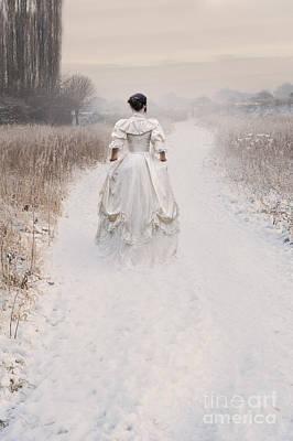 Victorian Woman Walking Through A Winter Meadow Poster by Lee Avison