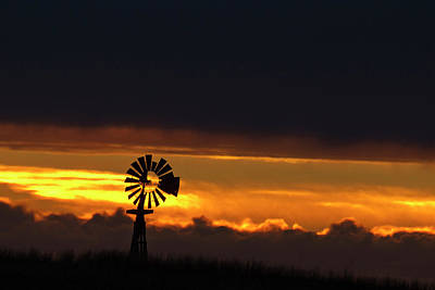 Windmill Silhouetted Against The Sunset Poster by Chuck Haney