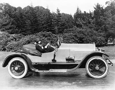 Woman Driving A Stutz Roadster Poster by Underwood Archives