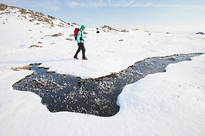 Woman Hill Walker By A Frozen Bog Poster by Ashley Cooper