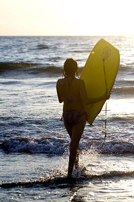 Woman On Beach Carrying Bodyboard Poster by Keith Levit