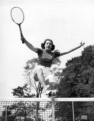 Woman Player Leaping Over Net Poster by Underwood Archives