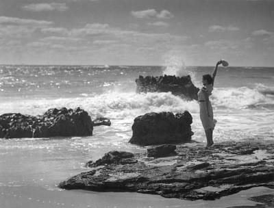 Woman Waving On Shore Poster by Underwood Archives