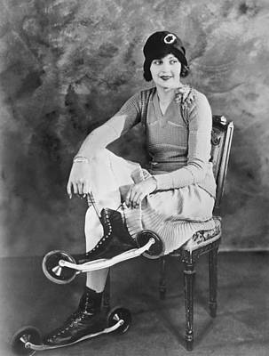 Woman With Her Bicycle Skates Poster by Underwood Archives