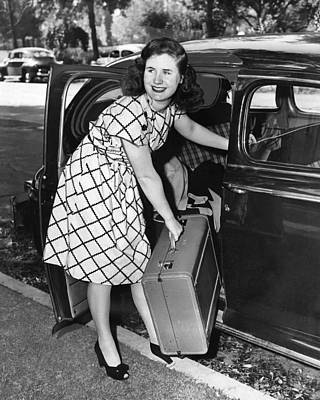 Woman With Suitcase Poster by Underwood Archives