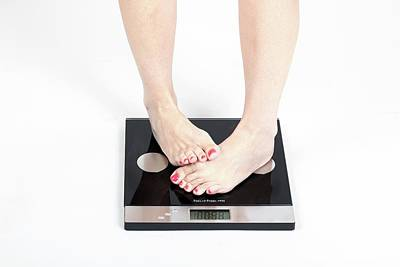 Woman's Feet On Scale Poster by Photostock-israel