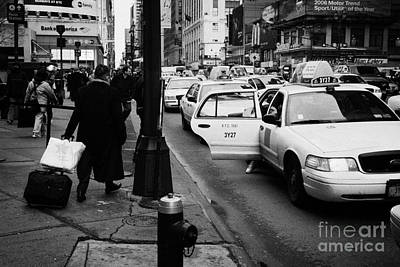 Yellow Cab On Taxi Rank Outside Madison Square Garden On 7th Avenue New York City Usa Poster by Joe Fox
