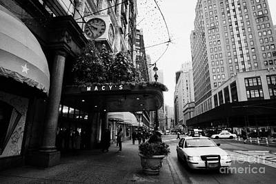 yellow taxi cab waits outside entrance to Macys department store on Broadway and 34th street Poster by Joe Fox