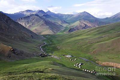 Yurts In The Tash Rabat Valley Of Kyrgyzstan  Poster by Robert Preston