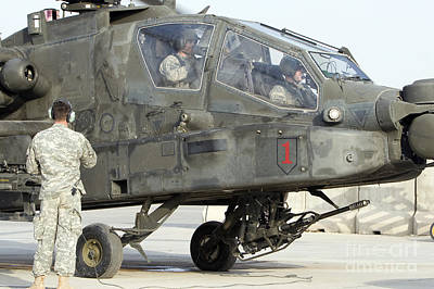 An Ah-64 Apache Prepares To Leave Poster by Terry Moore