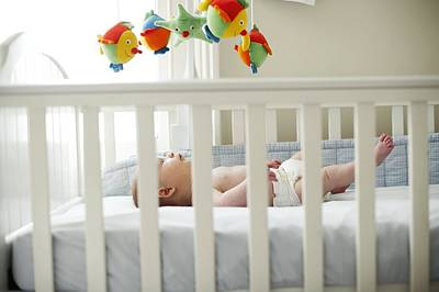 Baby Boy In His Cot Poster by Ian Boddy