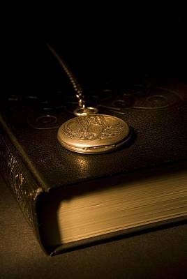 Gold Pocket Watch Resting On A Book Poster by Philippe Widling