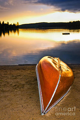 Lake Sunset With Canoe On Beach Poster by Elena Elisseeva