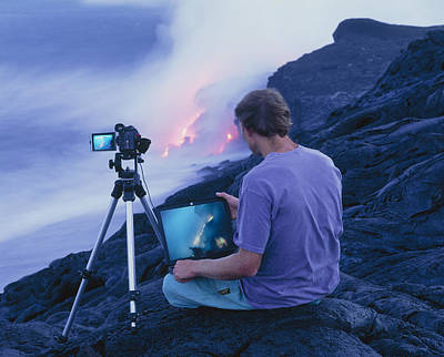Man Taking Photographs Of A Lava Flow Poster by G. Brad Lewis