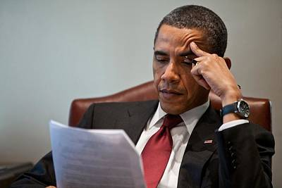 President Barack Obama Reads A Document Poster by Everett
