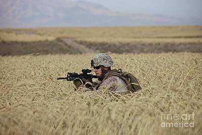U.s. Marine Patrols A Wadi Near Kunduz Poster by Terry Moore