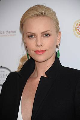 Charlize Theron At Arrivals Poster by Everett