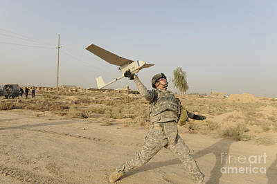 U.s. Army Soldier Launches An Rq-11 Poster by Stocktrek Images