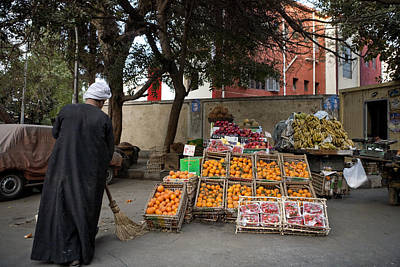 A Fruit Seller Sweeps In Front Poster by Taylor S. Kennedy
