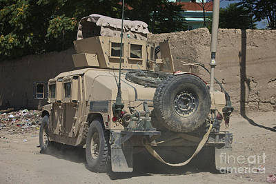 A Humvee Patrols The Streets Of Kunduz Poster by Terry Moore