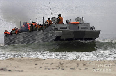A Polish Amphibious Vehicle Drives Onto Poster by Stocktrek Images