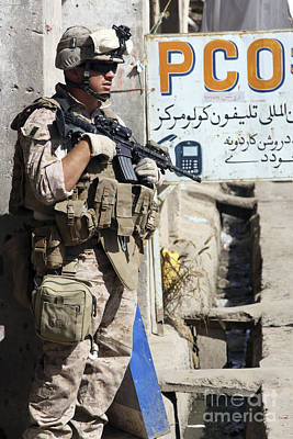 A Soldier Provides Security Poster by Stocktrek Images