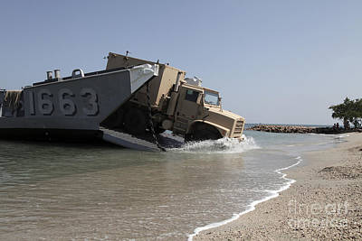 A Truck Offloads From A Landing Craft Poster by Stocktrek Images