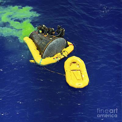 A U.s. Navy Frogman Team Helps Poster by Stocktrek Images