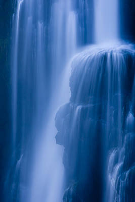 A Waterfall Splashes Off Of A Large Poster by Ralph Lee Hopkins
