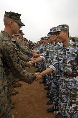 American And Chinese Marines Shake Poster by Stocktrek Images