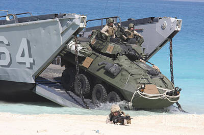 An Lav-25 Exits A Landing Craft Utility Poster by Stocktrek Images