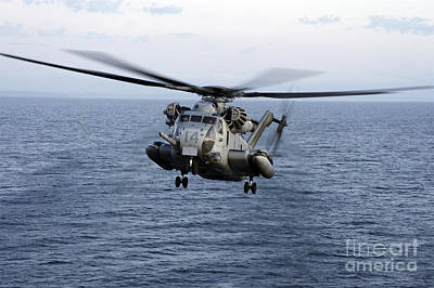 An Mh-53e Sea Dragon In Flight Poster by Stocktrek Images