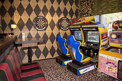Arcade Game Machines At A Diner Poster by Jaak Nilson