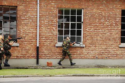 Belgian Soldiers On Patrol Poster by Luc De Jaeger
