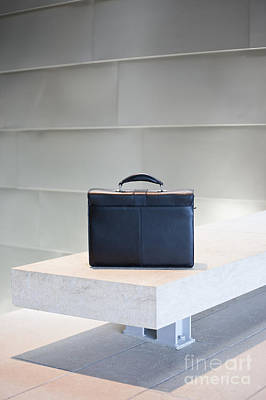 Black Briefcase On White Stone Bench Poster by Jetta Productions, Inc