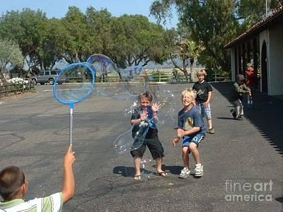 Blowing Bubbles Poster by Joan  Jones